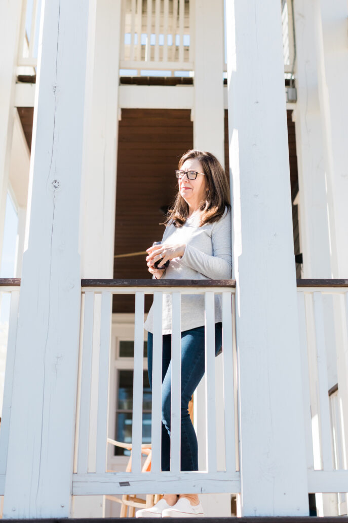 woman on porch at Carlton Landing