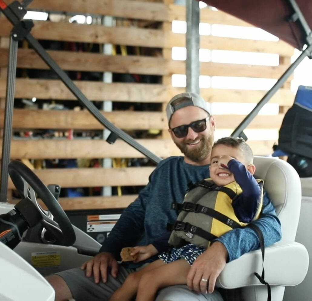 Kid in a life jacket with dad