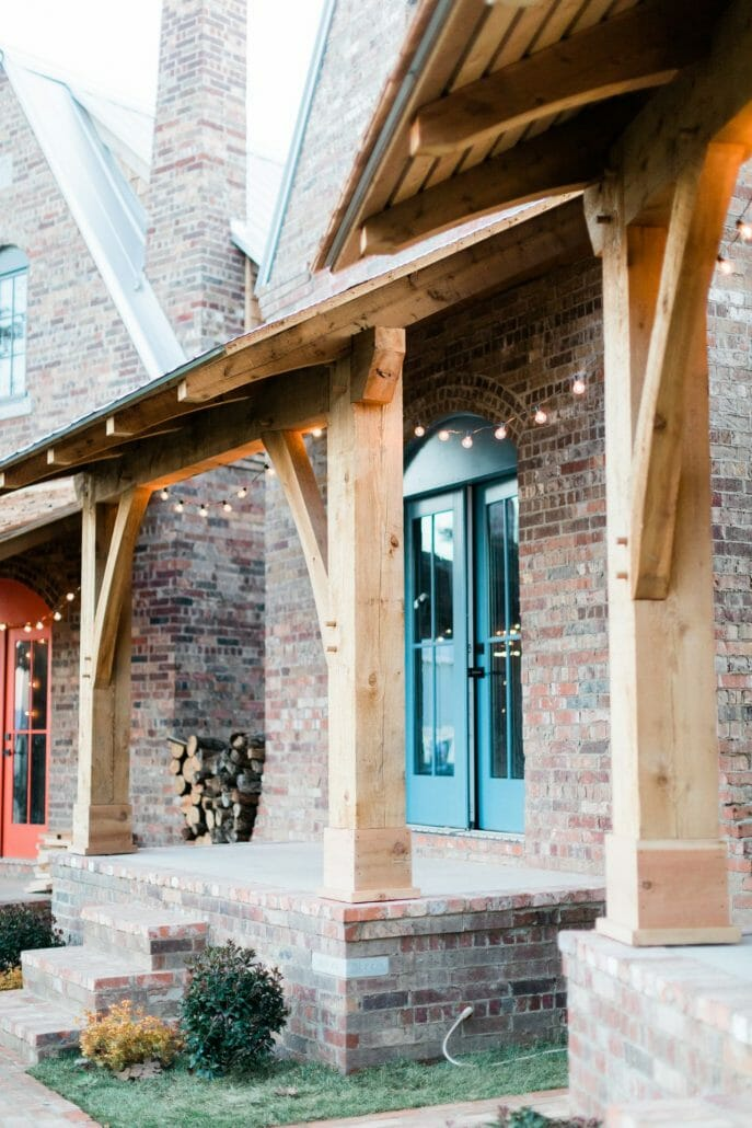 Wood porch on brick house