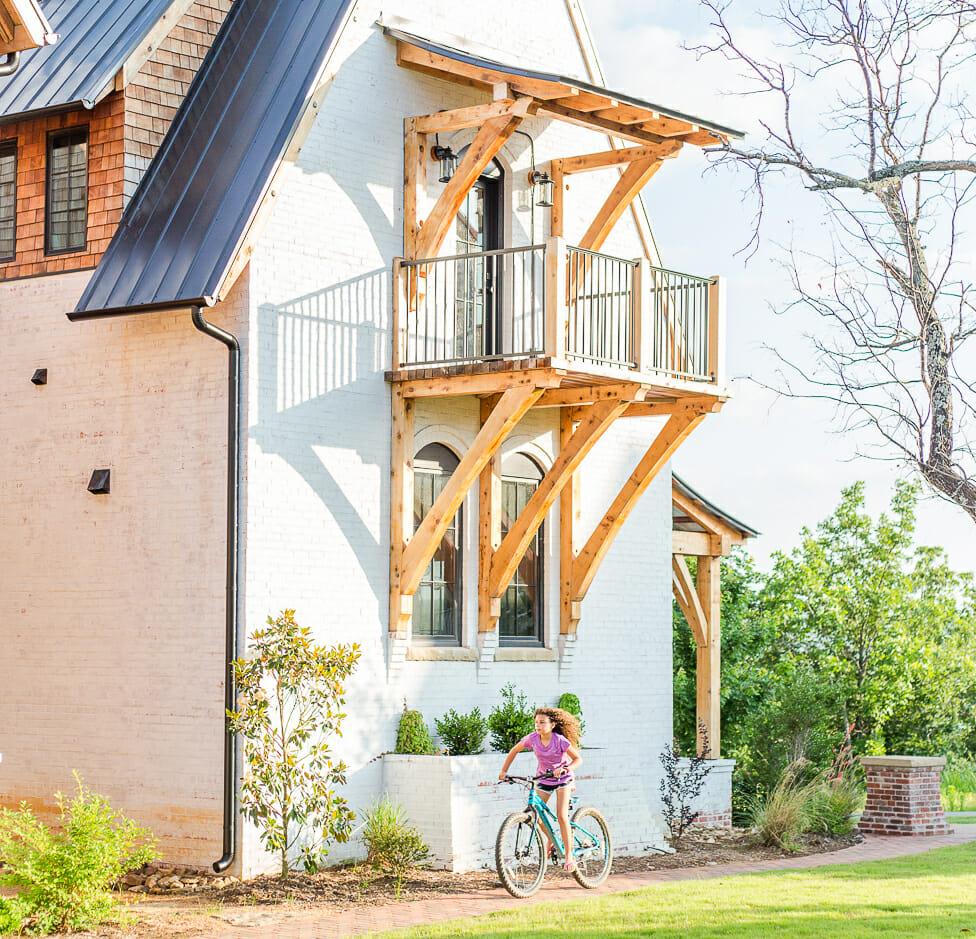 house with girl on bike