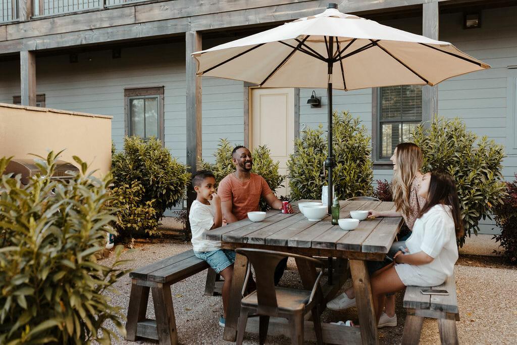 Family enjoying dinner at the Residence Club